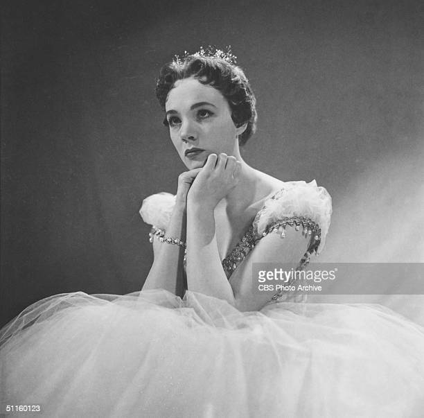 British actress Julie Andrews rests her chin in her hands as she poses on the set of CBS Television presentation of 'Cinderella' New York New York...
