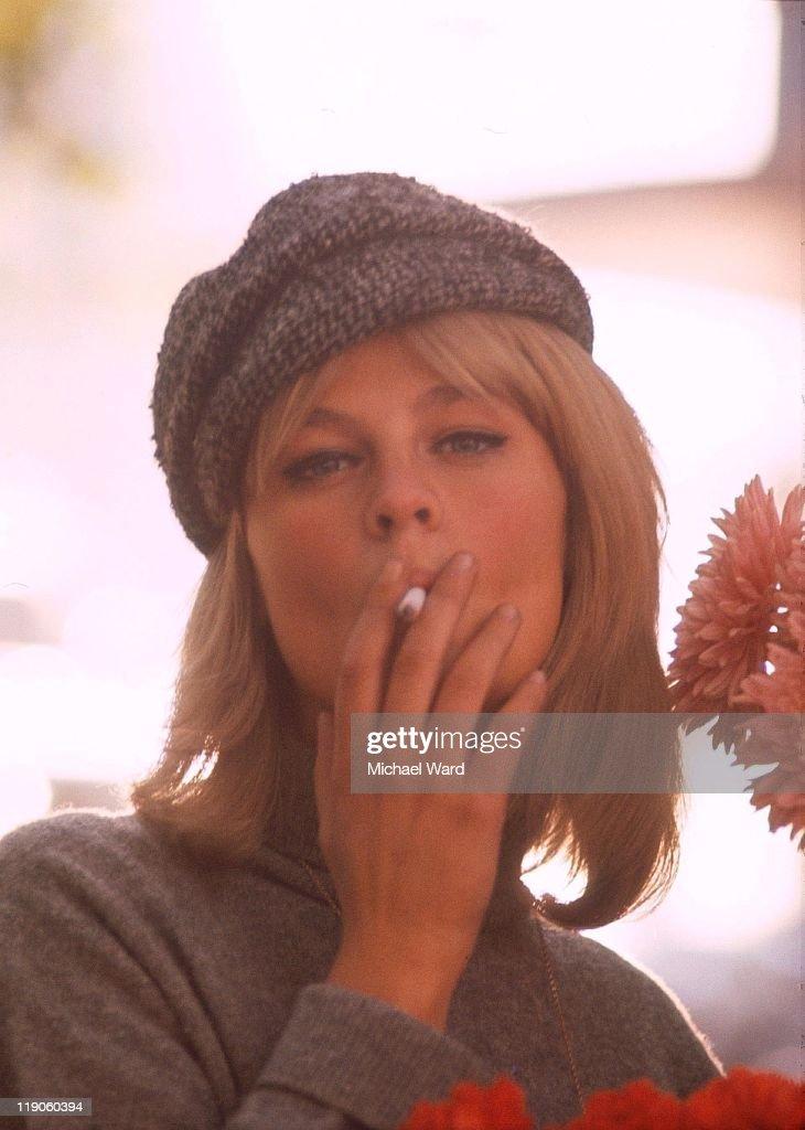 British actress Julie Christie smoking a cigarette, 1964.