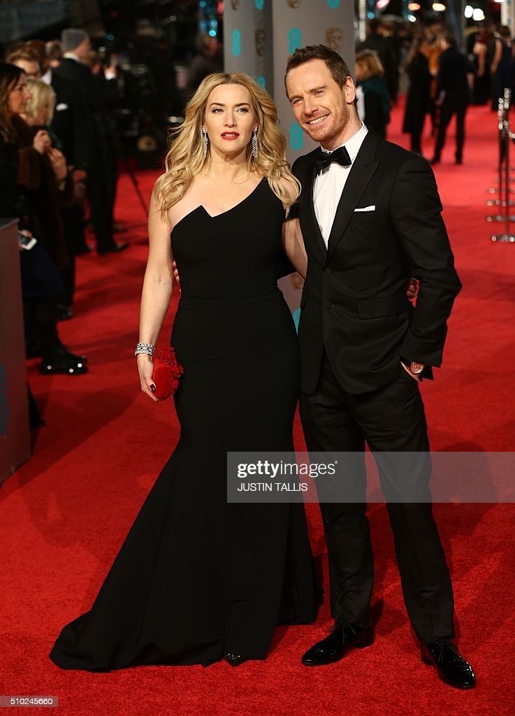 British actress Kate Winslet (L) and British actor Michael Fassbender pose on arrival for the BAFTA British Academy Film Awards at the Royal Opera House in London on February 14, 2016. TALLIS