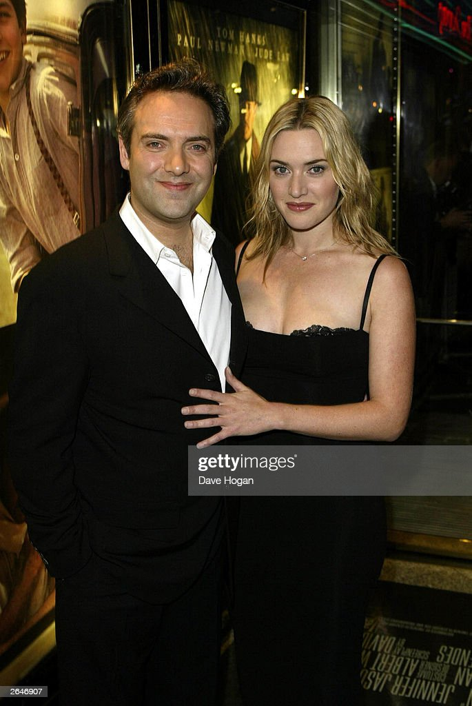 British actress <a gi-track='captionPersonalityLinkClicked' href=/galleries/search?phrase=Kate+Winslet&family=editorial&specificpeople=201923 ng-click='$event.stopPropagation()'>Kate Winslet</a> and director Sam Mendez arrive at the premiere party for the film 'Road to Perdition' at Claridge's on September 18, 2002 in London.