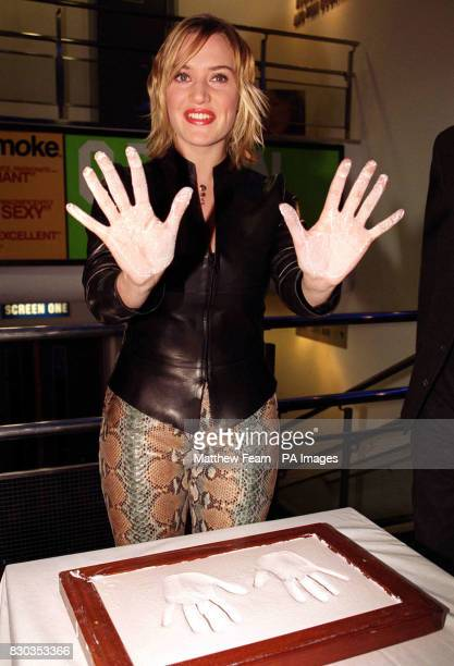 British actress Kate Winslet places her hands in plaster before the charity premiere of her new film Holy Smoke at the Odeon West End cinema in...