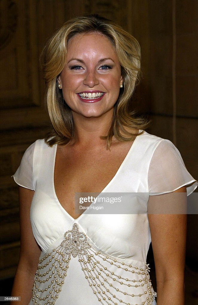 British actress Kim Medcalf celebrates after winning the award for 'Most Popular Newcomer' for the programme 'Eastenders' at the National TV Awards party at the Royal Albert Hall on October 15, 2002 in London.