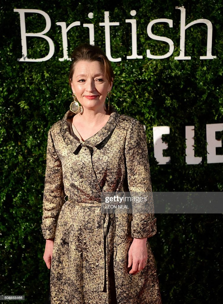 British actress Lesley Manville poses on arrival for the British film awards in central London on February 7, 2016. / AFP / LEON NEAL