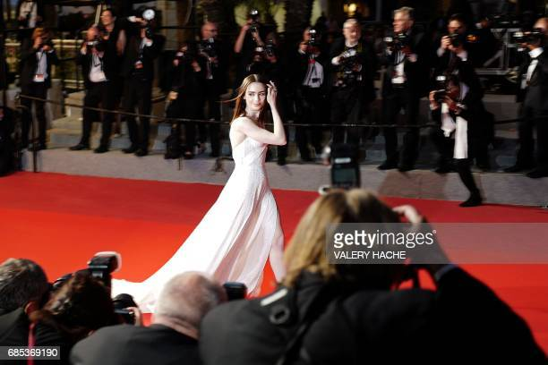 TOPSHOT British actress Lily Collins leaves the Festival Palace after attending on May 19 2017 the screening of the film 'Okja' at the 70th edition...