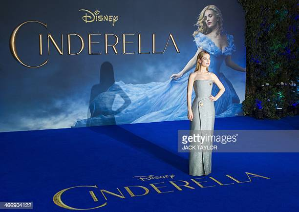 British actress Lily James poses for photographers on the red carpet ahead of the UK premiere of the film 'Cinderella' in central London on March 19...