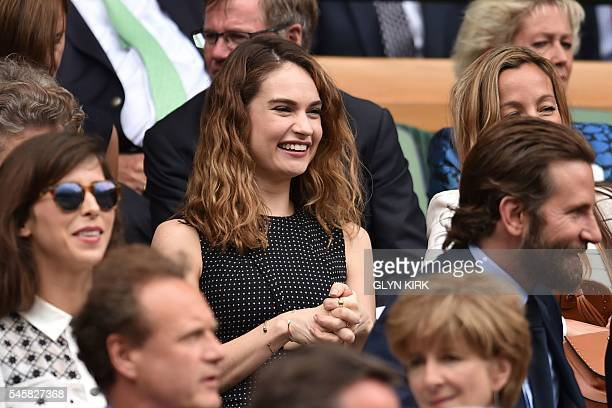 British actress Lily James sits in the royal box on centre court before the men's singles final match on the last day of the 2016 Wimbledon...