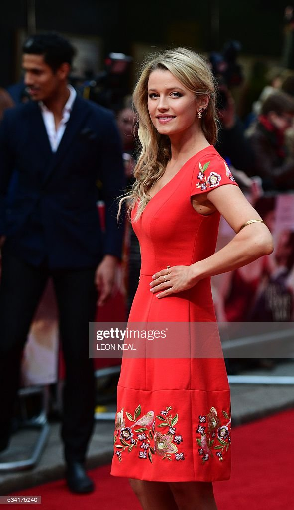 British actress Lily Travers poses for pictures as she arrives for the European Premiere of the film 'Me Before You' in central London, on May 25, 2016. / AFP / LEON