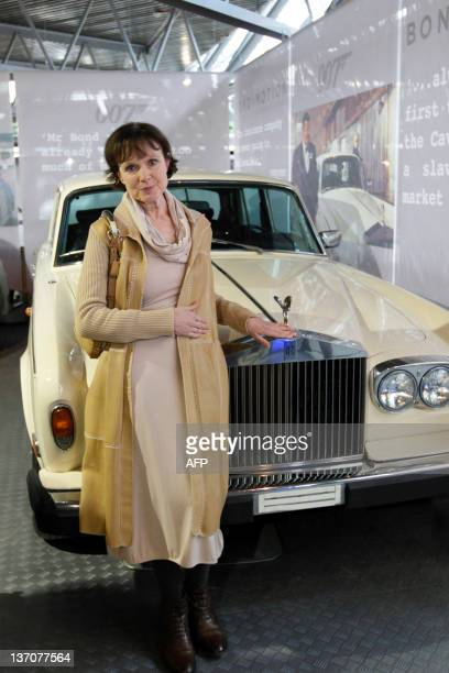 British actress Madeline Smith poses for photographers in front of a RollsRoyce Silver Shadow 2 at the opening of a press preview of the Bond in...