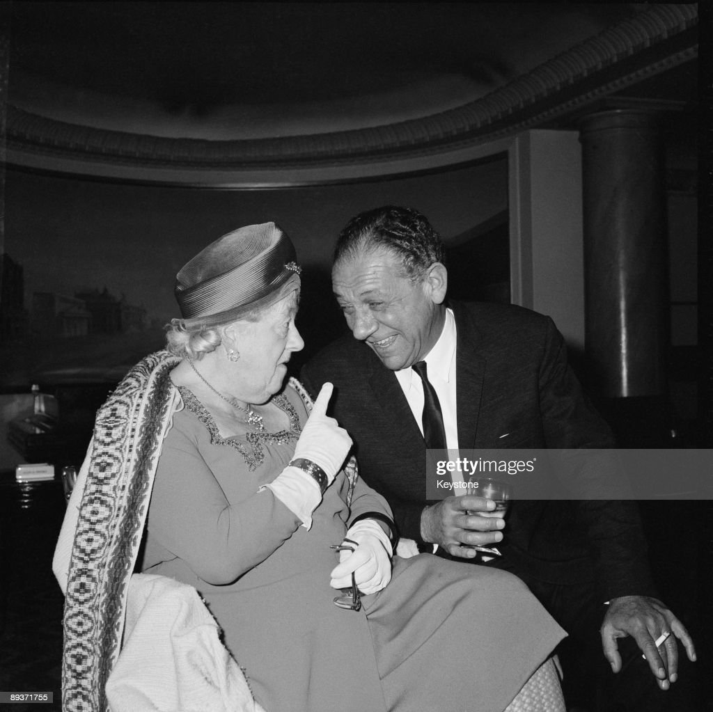 British actress Margaret Rutherford (1892 - 1972) in conversation with actor Sid James (1913 - 1976) at the Saville Theatre in London, 12th April 1965. The two are about to appear in a run of the comedy 'The Solid Gold Cadillac' on stage.