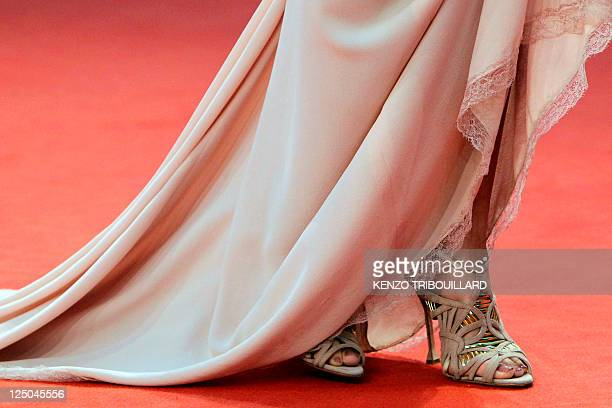 British actress Naomi Watts's dress and shoes are pictured as she poses on the red carpet prior to her tribute ceremony at the 37th US Film Festival...