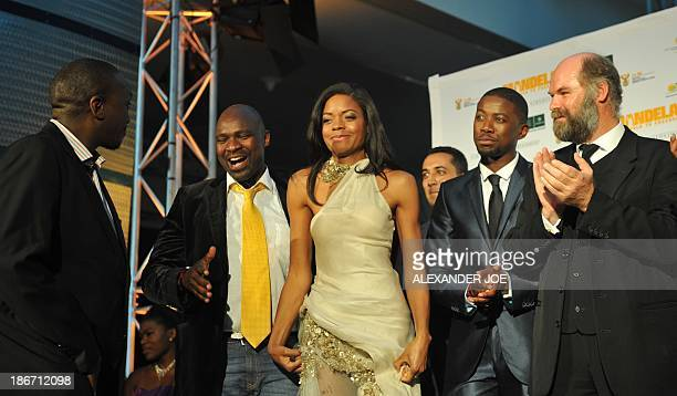 British actress Naomie Harris who plays the role of Winnie Mandela in the movie 'Mandela Long Walk to Freedom' smiles on the day of the movie's...