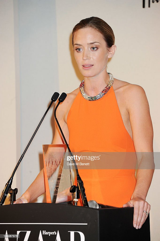 (MANDATORY CREDIT PHOTO BY DAVE M BENETT/GETTY IMAGES REQUIRED) British Actress of the Year winner <a gi-track='captionPersonalityLinkClicked' href=/galleries/search?phrase=Emily+Blunt&family=editorial&specificpeople=213480 ng-click='$event.stopPropagation()'>Emily Blunt</a> accepts her award at the Harper's Bazaar Women of the Year Awards 2012, in association with Estee Lauder, Harrods and Tiffany & Co., at Claridge's Hotel on October 31, 2012 in London, England.