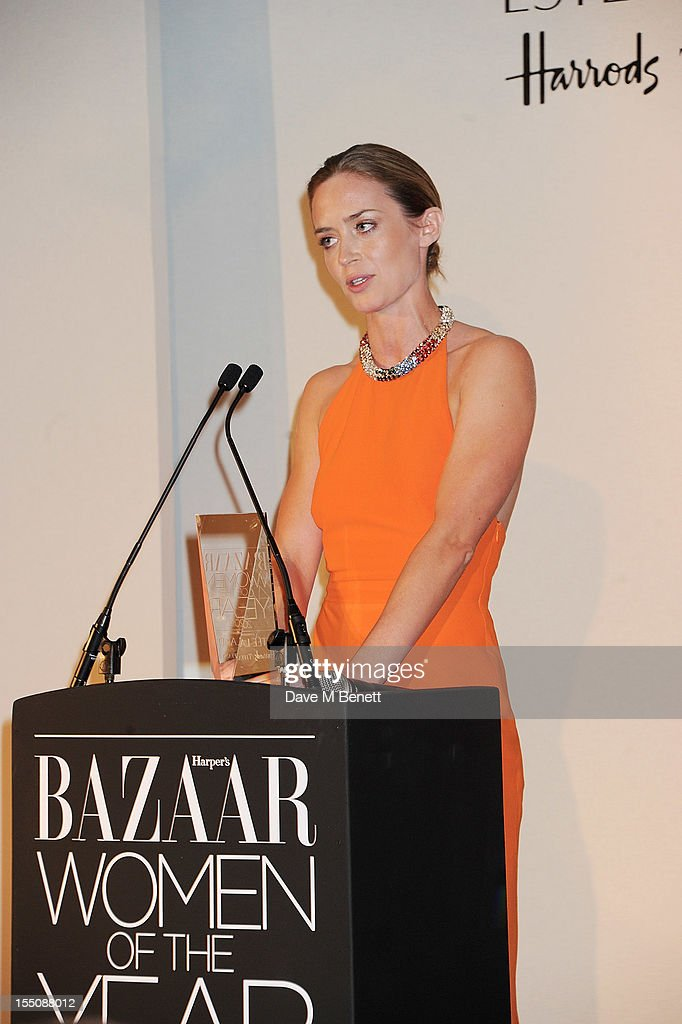 (MANDATORY CREDIT PHOTO BY DAVE M BENETT/GETTY IMAGES REQUIRED) British Actress of the Year winner Emily Blunt accepts her award at the Harper's Bazaar Women of the Year Awards 2012, in association with Estee Lauder, Harrods and Tiffany & Co., at Claridge's Hotel on October 31, 2012 in London, England.