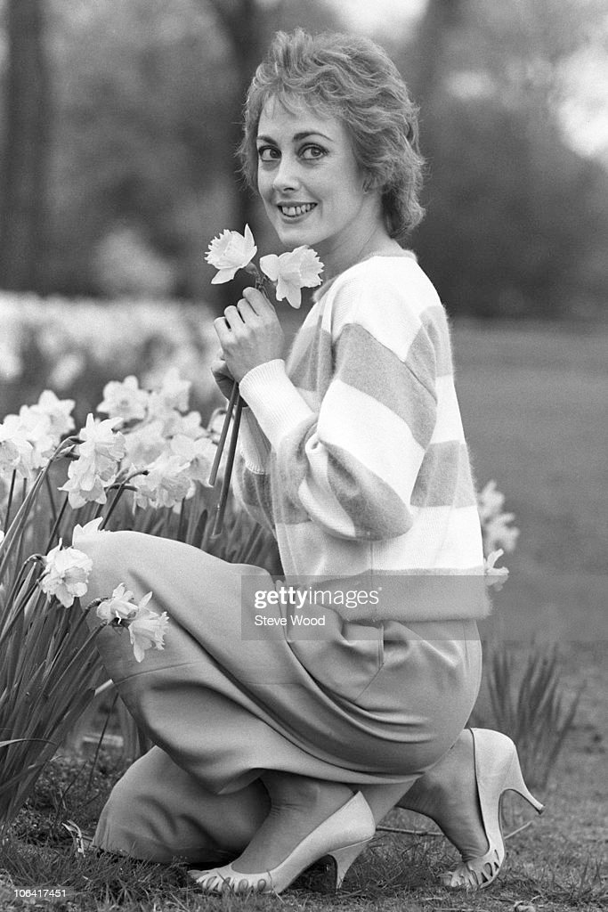 British actress Paula Wilcox poses with some daffodils on April 10, 1984.