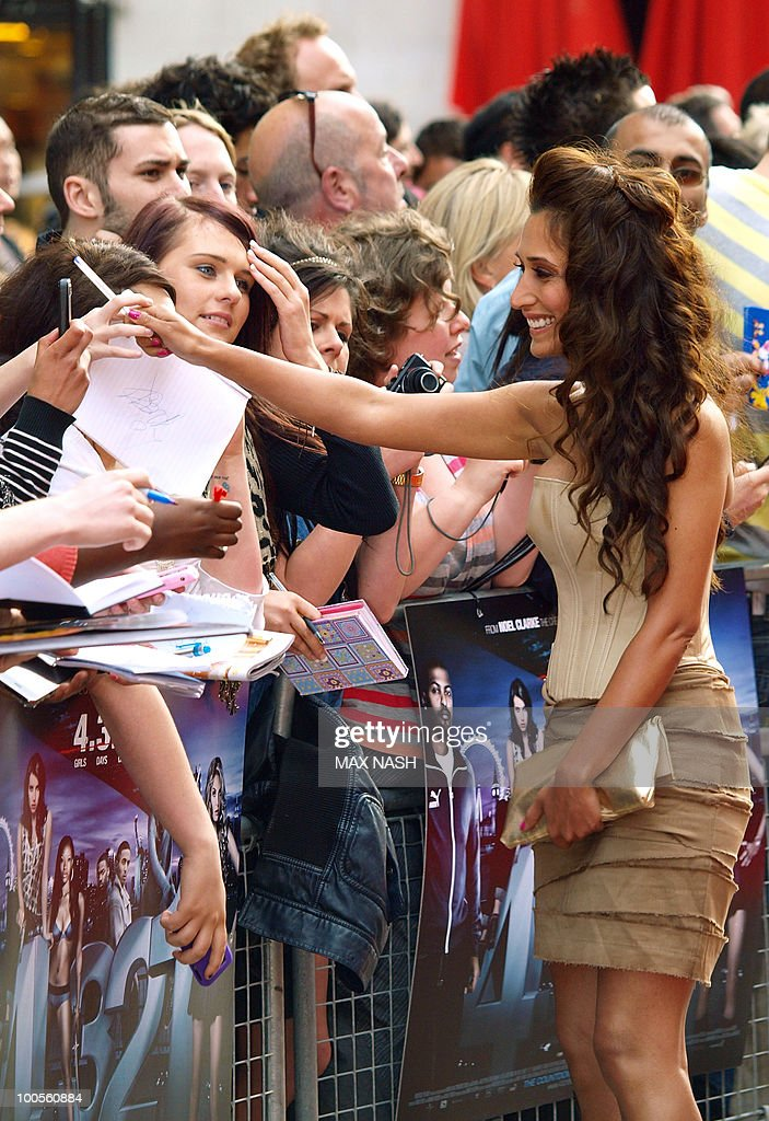 British actress Preeya Kalidas greets her fans as she arrives at the World Premiere of her latest film, '4.3.2.1' in London's Leicester Square on May 25, 2010. AFP Photo/MAX