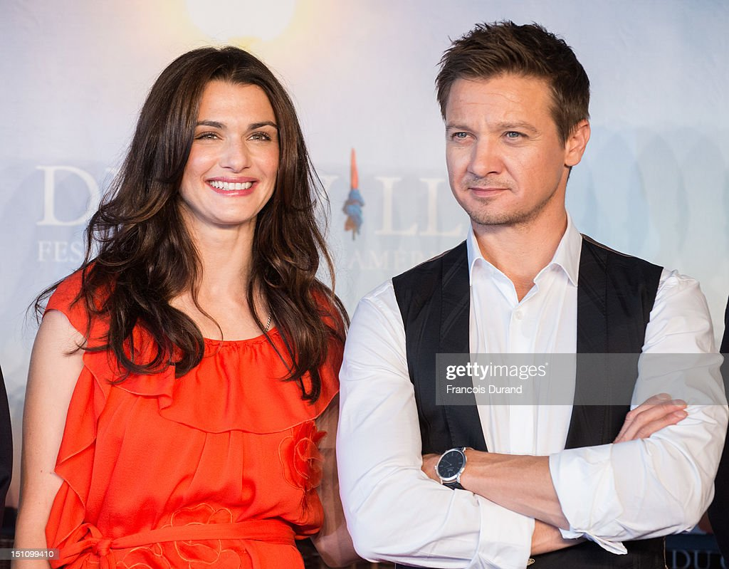 British actress <a gi-track='captionPersonalityLinkClicked' href=/galleries/search?phrase=Rachel+Weisz&family=editorial&specificpeople=204656 ng-click='$event.stopPropagation()'>Rachel Weisz</a> and US actor <a gi-track='captionPersonalityLinkClicked' href=/galleries/search?phrase=Jeremy+Renner&family=editorial&specificpeople=708701 ng-click='$event.stopPropagation()'>Jeremy Renner</a> (R) pose at 'The Bourne Legacy' Photocall during 38th Deauville American Film Festival on September 1, 2012 in Deauville, France.