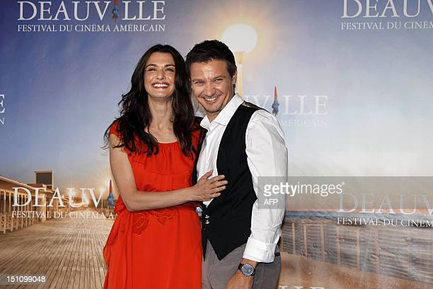 British actress Rachel Weisz and US actor Jeremy Renner pose during a photocall for the film 'The Bourne Legacy ' during the 38th Deauville's US Film...