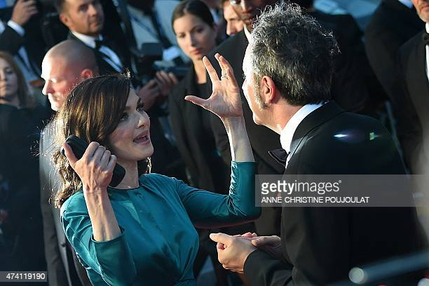 British actress Rachel Weisz talks with Italian director Paolo Sorrentino before leaving the Festival palace after the screening of the film 'Youth'...