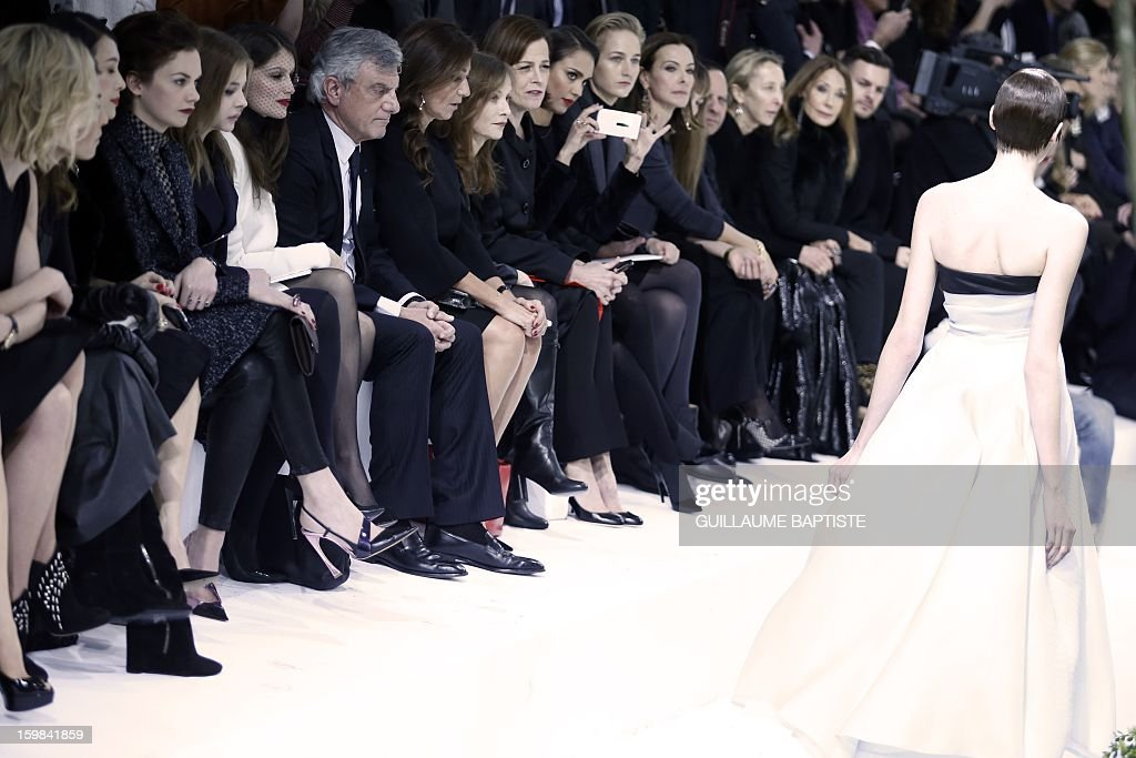 British actress Rosamund Pike, Swedish actress Noomi Rapace, Chinese actress Zhang Ziyi, British actress Ruth Wilson, US actress Chloe Grace Moretz, French actress Laetitia Casta, Christian Dior CEO Sidney Toledano and his wife Katia, French actress Isabelle Huppert, US actresses Sigourney Weaver, Jessica Alba and Leelee Sobieski, French actress Carole Bouquet, French jewellery designer Victoire de Castellane, Tunisian-born fashion designer Azzedine Alaia, Italian fashion editor and gallerist Carla Sozzani and US actress Marisa Berenson attend the Christian Dior Haute Couture Spring-Summer 2013 collection show by Belgian designer Raf Simons on January 21, 2013 in Paris.