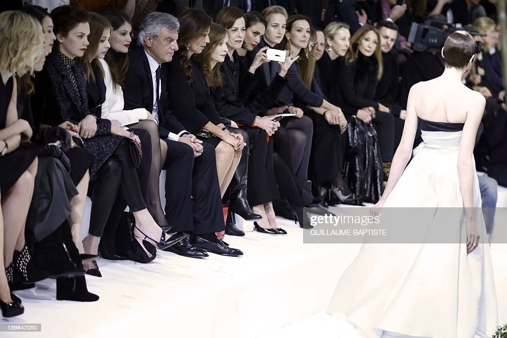 British actress Rosamund Pike, Swedish actress Noomi Rapace, Chinese actress Zhang Ziyi, British actress Ruth Wilson, US actress Chloe Grace Moretz, French actress Laetitia Casta, Christian Dior CEO Sidney Toledano and his wife Katia, French actress Isabelle Huppert, US actresses Sigourney Weaver, Jessica Alba and Leelee Sobieski French actress Carole Bouquet, French jewellery designer Victoire de Castellane, Tunisian-born fashion designer Azzedine Alaia, Italian fashion editor and gallerist Carla Sozzani and US actress Marisa Berenson (2ndR) attend the Christian Dior Haute Couture Spring-Summer 2013 collection show by Belgian designer Raf Simons on January 21, 2013 in Paris.