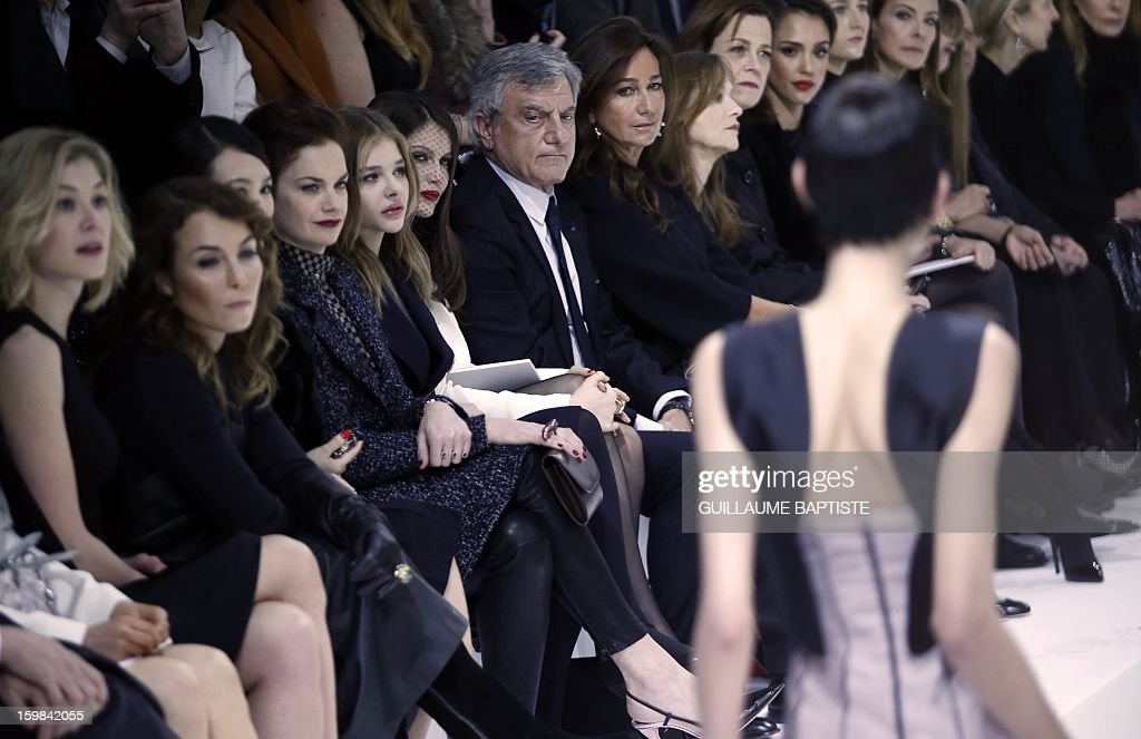 British actress Rosamund Pike, Swedish actress Noomi Rapace, Chinese actress Zhang Ziyi, British actress Ruth Wilson, US actress Chloe Grace Moretz, French actress Laetitia Casta, Christian Dior CEO Sidney Toledano and his wife Katia, French actress Isabelle Huppert, US actresses Sigourney Weaver, Jessica Alba attend the Christian Dior Haute Couture Spring-Summer 2013 collection show by Belgian designer Raf Simons on January 21, 2013 in Paris.