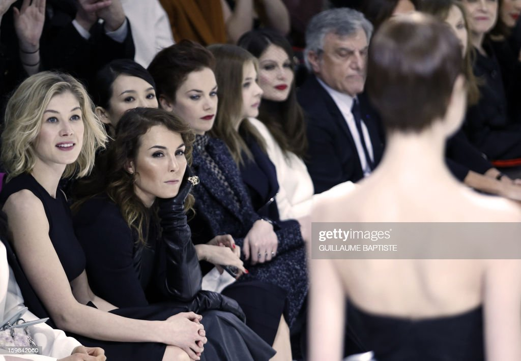 British actress Rosamund Pike, Swedish actress Noomi Rapace, Chinese actress Zhang Ziyi, British actress Ruth Wilson, US actress Chloe Grace Moretz, French actress Laetitia Casta, Christian Dior CEO Sidney Toledano attend the Christian Dior Haute Couture Spring-Summer 2013 collection show by Belgian designer Raf Simons on January 21, 2013 in Paris.