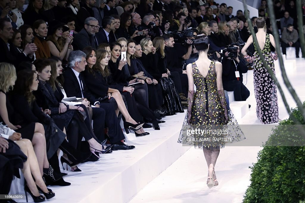 British actress Rosamund Pike, Swedish actress Noomi Rapace, Chinese actress Zhang Ziyi, British actress Ruth Wilson, US actress Chloe Grace Moretz, French actress Laetitia Casta, Christian Dior CEO Sidney Toledano and his wife Katia, French actress Isabelle Huppert, US actresses Sigourney Weaver, Jessica Alba and Leelee Sobieski, French actress Carole Bouquet, French jewellery designer Victoire de Castellane, Tunisian-born Azzedine Alaia, Italian fashion editor and gallerist Carla Sozzani and US actress Marisa Berenson attend the Christian Dior Haute Couture Spring-Summer 2013 collection show by Belgian designer Raf Simons on January 21, 2013 in Paris.