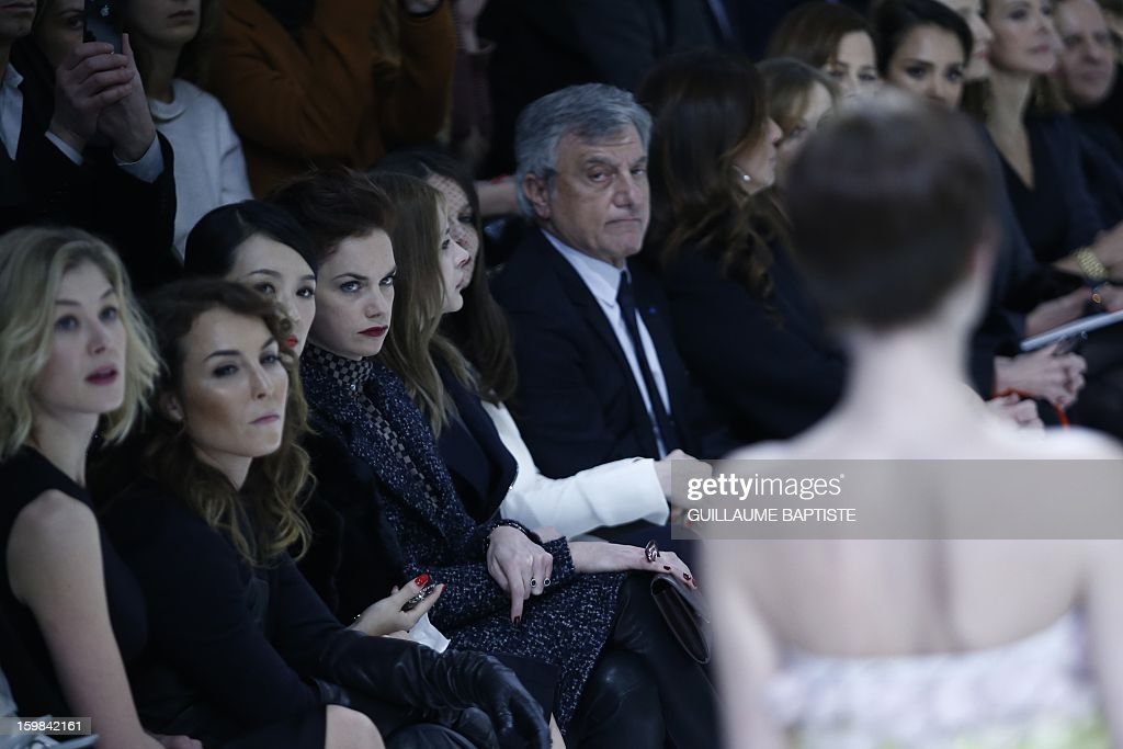 British actress Rosamund Pike, Swedish actress Noomi Rapace, Chinese actress Zhang Ziyi, British actress Ruth Wilson, US actress Chloe Grace Moretz, French actress Laetitia Casta, Christian Dior CEO Sidney Toledano and his wife Katia, French actress Isabelle Huppert, US actresses Sigourney Weaver, Jessica Alba and Leelee Sobieski, French actress Carole Bouquet, Tunisian-born Azzedine Alaia attend the Christian Dior Haute Couture Spring-Summer 2013 collection show by Belgian designer Raf Simons on January 21, 2013 in Paris.