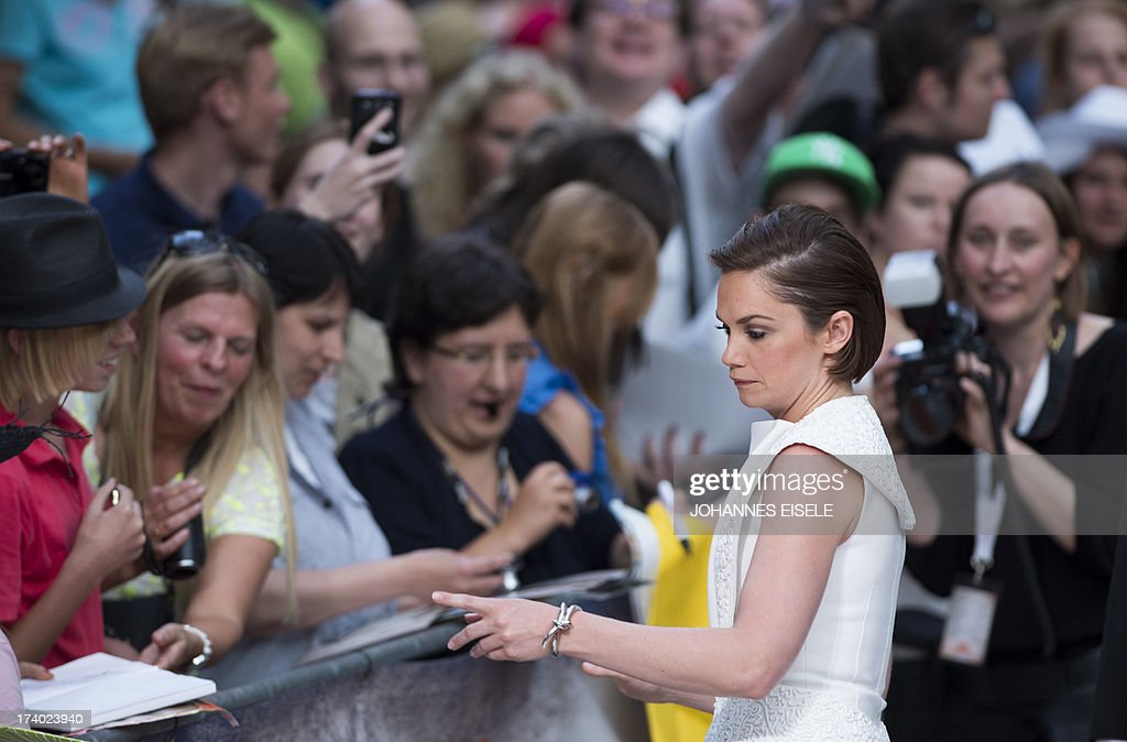 British actress Ruth Wilson signs autographs as she arrives for the premiere of the film 'The Lone Ranger' on July 19, 2013 in Berlin. The film will start in German cinemas on August 8, 2013. AFP PHOTO / JOHANNES EISELE
