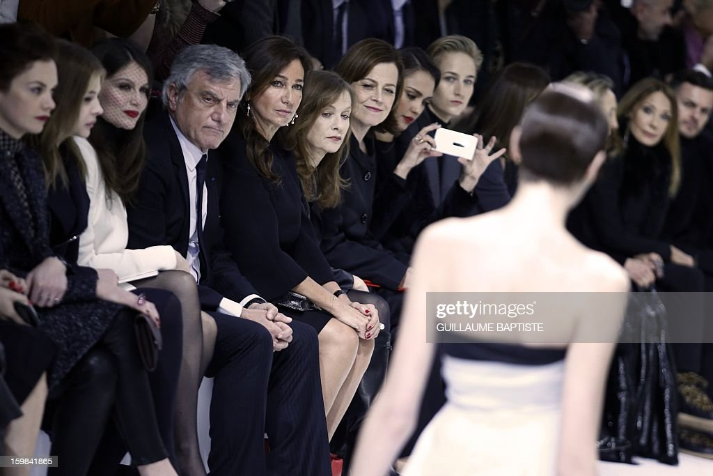 British actress Ruth Wilson, US actress Chloe Grace Moretz, French actress Laetitia Casta, Christian Dior CEO Sidney Toledano and his wife Katia, French actress Isabelle Huppert, US actresses Sigourney Weaver, Jessica Alba and Leelee Sobieski, French actress Carole Bouquet, French jewellery designer Victoire de Castellane and US actress Marisa Berenson attend the Christian Dior Haute Couture Spring-Summer 2013 collection show by Belgian designer Raf Simons on January 21, 2013 in Paris.