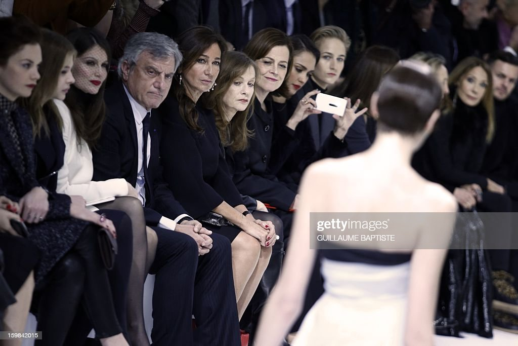 British actress Ruth Wilson, US actress Chloe Grace Moretz, French actress Laetitia Casta, Christian Dior CEO Sidney Toledano and his wife Katia, French actress Isabelle Huppert, US actresses Sigourney Weaver, Jessica Alba, Leelee Sobieski and Marisa Berenson (2ndR) attend the Christian Dior Haute Couture Spring-Summer 2013 collection show by Belgian designer Raf Simons on January 21, 2013 in Paris.
