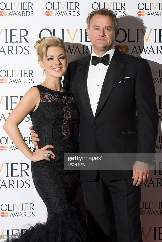 British actress Sheridan Smith (L) and Biriths actor Hugh Bonneville pose for photographers during the Lawrence Olivier Awards for theatre at the Royal Opera House in London on April 28, 2013. AFP PHOTO/Leon Neal