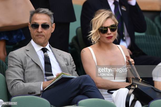 British actress Sienna Miller sits on Center Court ahead of the men's semifinal match between Serbia's Novak Djokovic and France's Richard Gasquet on...