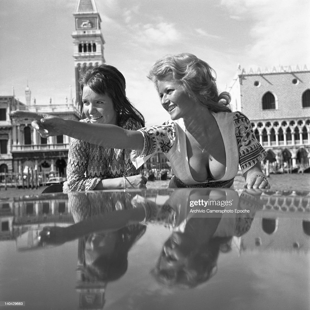 British actress Stephanie Beacham, on the right, standing on a water taxi with Verna Harvey, Venice, 1971.
