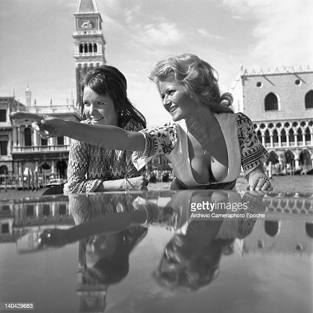 British actress Stephanie Beacham on the right standing on a water taxi with Verna Harvey Venice 1971