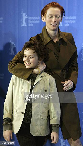 British actress Tilda Swinton and US actor Aidan Gould joke during the photocall of their movie 'Julia' by French director Erick Zonca and presented...