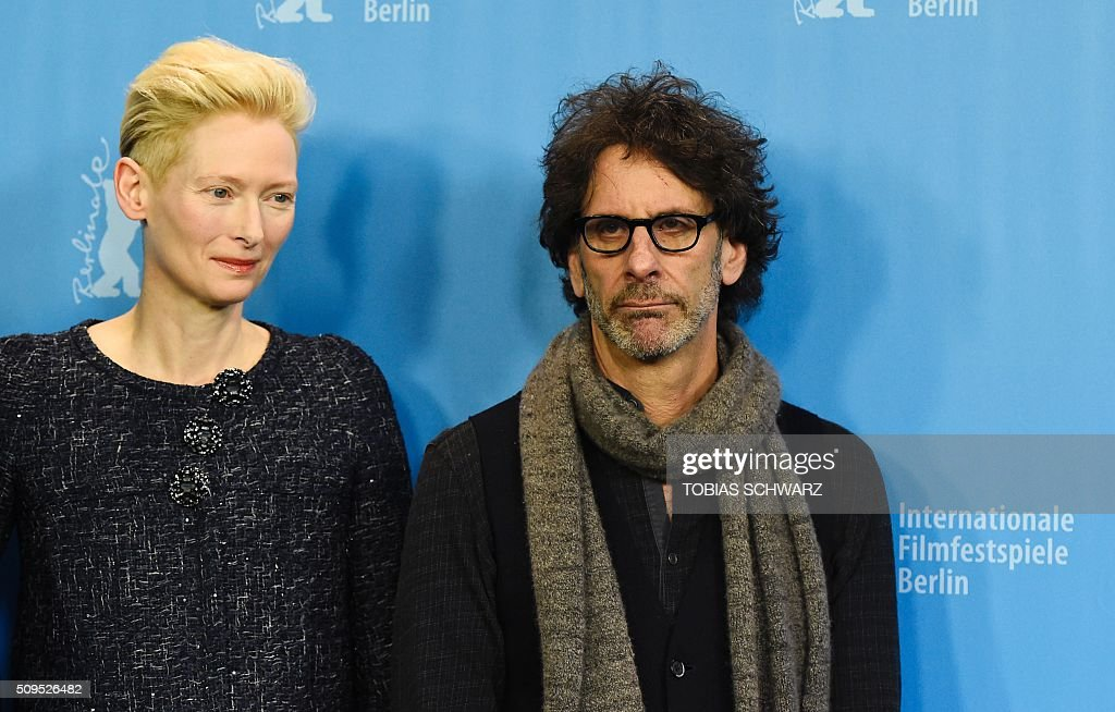 British actress Tilda Swinton (L) and US director Joel Coen pose during the photo call for the film 'Hail, Caesar!' screened as opening film of the 66th Berlinale Film Festival in Berlin on February 11, 2016. The 66th Berlin film festival starts on February 11, 2016 with a spotlight on Europe's refugee crisis. / AFP / TOBIAS SCHWARZ