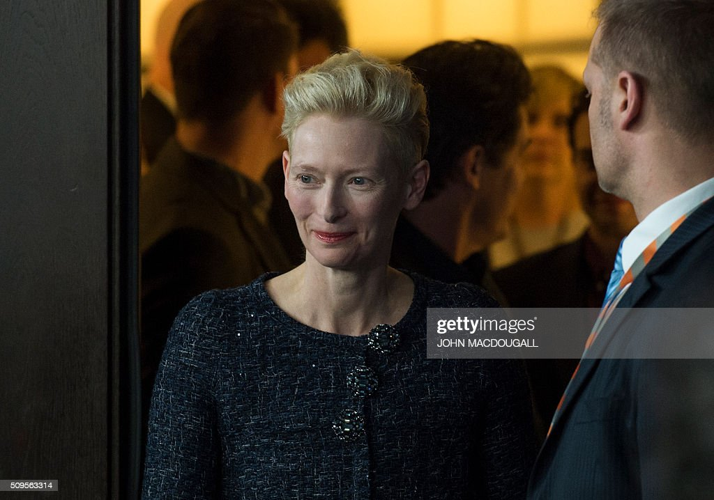 British actress Tilda Swinton arrives for a photocall for the film 'Hail, Caesar!' screened as opening film of the 66th Berlinale Film Festival in Berlin on February 11, 2016. The 66th Berlin film festival starts on February 11, 2016 with a spotlight on Europe's refugee crisis. / AFP / John MACDOUGALL