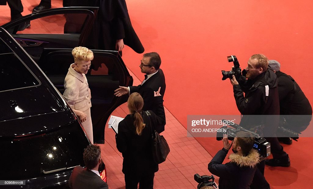British actress Tilda Swinton arrives on the red carpet ahead of the film 'Hail, Caesar!' screening as opening film of the 66th Berlinale Film Festival in Berlin on February 11, 2016. / AFP / ODD ANDERSEN
