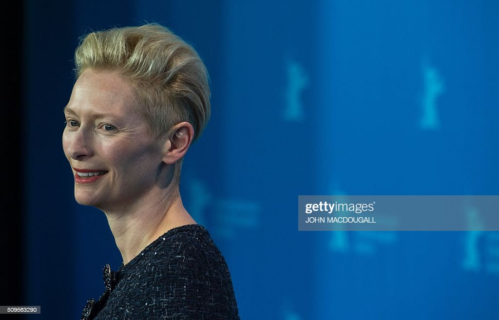 British actress Tilda Swinton attends a photocall for the film 'Hail, Caesar!' screened as opening film of the 66th Berlinale Film Festival in Berlin on February 11, 2016. The 66th Berlin film festival starts on February 11, 2016 with a spotlight on Europe's refugee crisis. / AFP / John MACDOUGALL