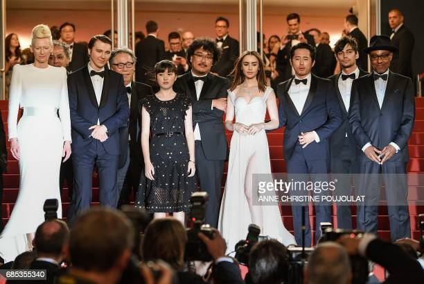 TOPSHOT British actress Tilda Swinton FrenchIranian cinematographer Darius Khondji US actor Paul Dano South Korean actor Byung Heebong South Korean...