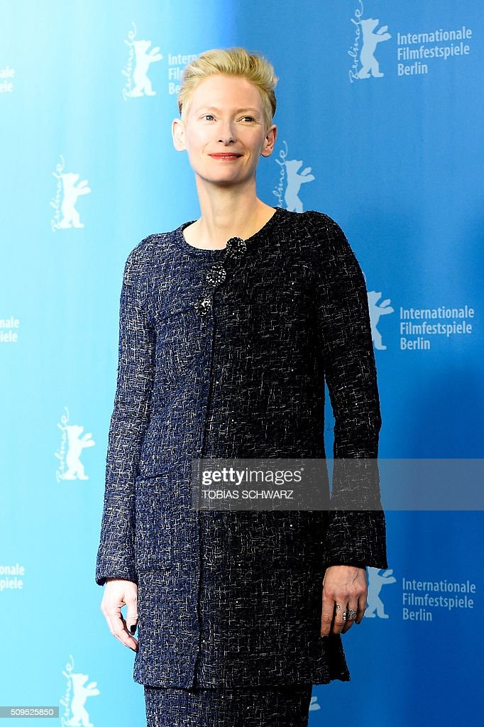 British actress Tilda Swinton poses during the photo call for the film 'Hail, Cesar!' screened as opening film of the 66th Berlinale Film Festival in Berlin on February 11, 2016. The 66th Berlin film festival starts on February 11, 2016 with a spotlight on Europe's refugee crisis. / AFP / TOBIAS SCHWARZ