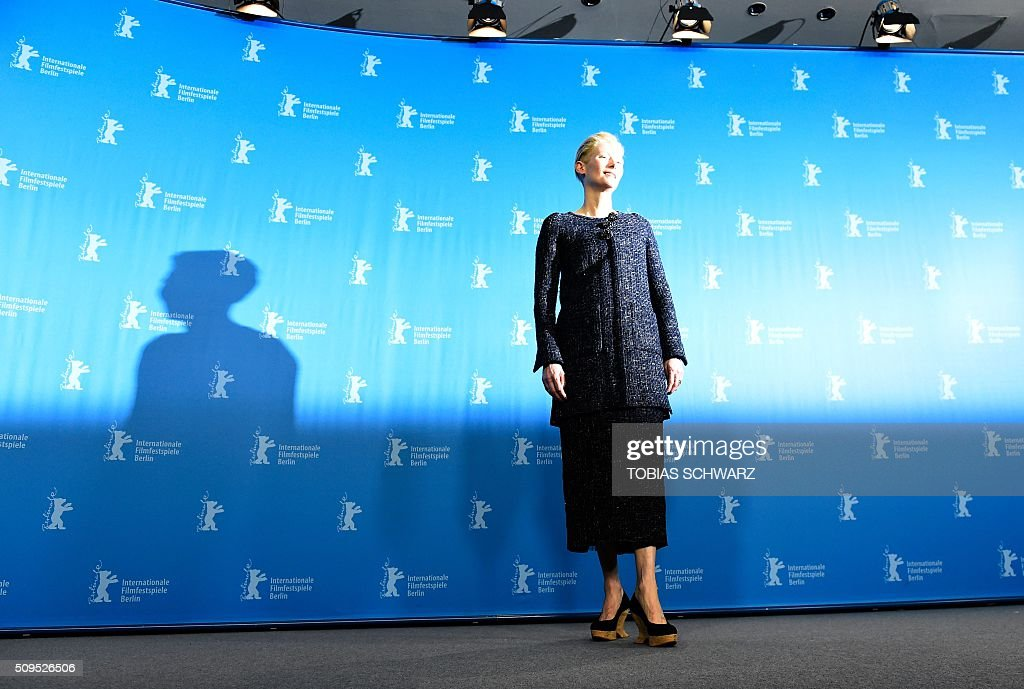 British actress Tilda Swinton poses during the photo call for the film 'Hail, Caesar!' screened as opening film of the 66th Berlinale Film Festival in Berlin on February 11, 2016. The 66th Berlin film festival starts on February 11, 2016 with a spotlight on Europe's refugee crisis. / AFP / TOBIAS SCHWARZ
