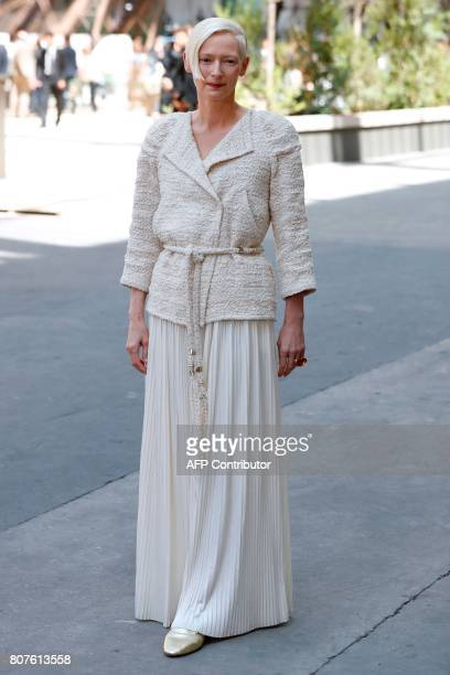 British actress Tilda Swinton poses during the photocall before Chanel 20172018 fall/winter Haute Couture collection show in Paris on July 4 2017 /...