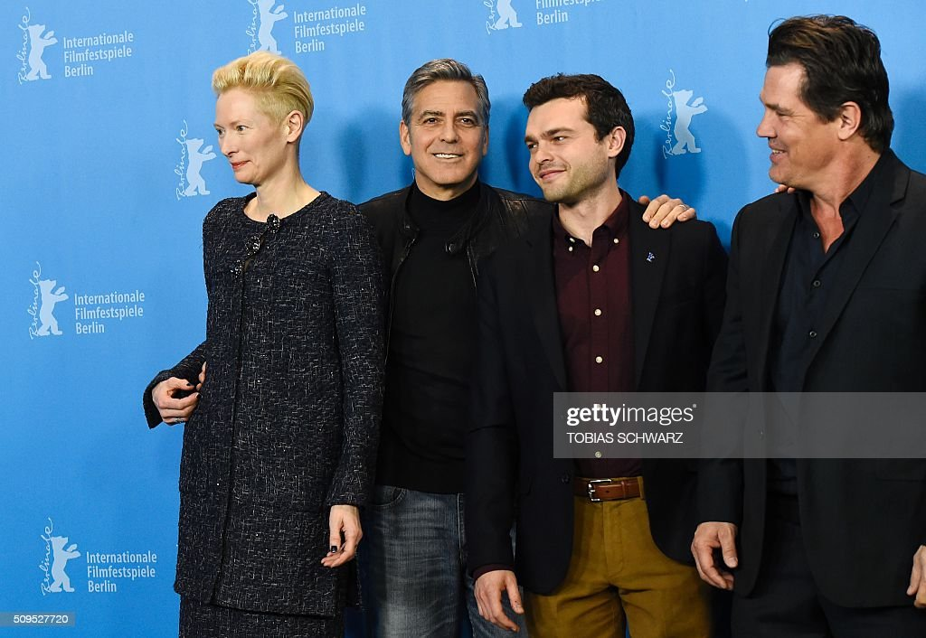 British actress Tilda Swinton, US actor George Clooney, US actor Alden Ehrenreich and US actor Josh Brolin pose during the photo call for the film 'Hail, Caesar!' screened as opening film of the 66th Berlinale Film Festival in Berlin on February 11, 2016. The 66th Berlin film festival starts on February 11, 2016 with a spotlight on Europe's refugee crisis. / AFP / TOBIAS SCHWARZ