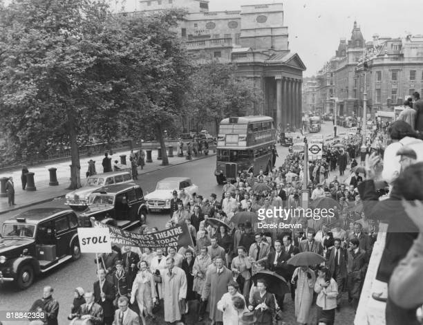 British actress Vivien Leigh and her husband actor Laurence Olivier lead a protest march against the proposed closing of the St James' Theatre in...