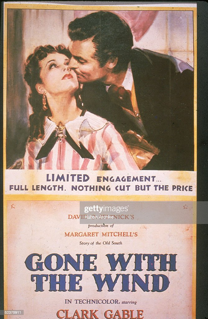 British actress Vivien Leigh as Scarlett O'Hara gets a kiss on the cheek from American actor Clark Gable as Rhett Butler in this promotional poster...