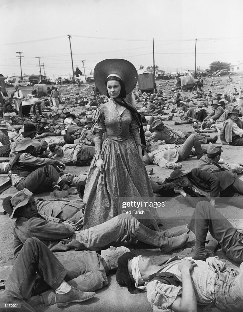 British actress Vivien Leigh surrounded by wounded Confederate soldiers in her role as Scarlett O'Hara in the American civil war epic 'Gone With the...