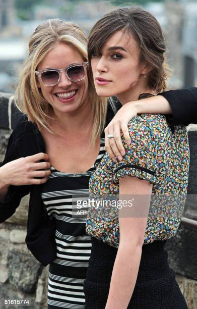 British actresses' Sienna Miller and Keira Knightley pose for photographers at Edinburgh Castle in Scotland prior to the world premiere of their...