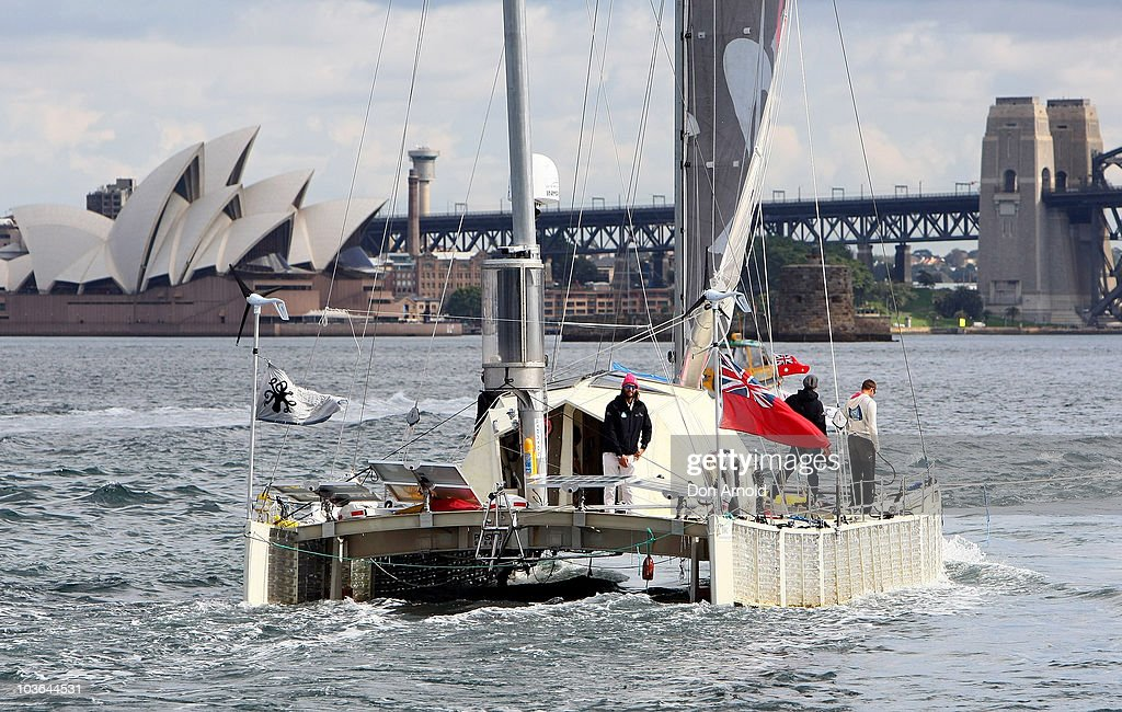 British adventurer and environmentalist David de Rothschild sails as the 'Plastiki' arrives at Sydney Harbour, completing the 12,860 kilometre journey from San Francisco to raise environmental awareness on on July 26, 2010 in Sydney, Australia.The 60-foot catamaran made from 12,500 plastic bottles was designed by Australian Andrew Dovall and embarked on the 128 day journey to bring attention to condition of our oceans and the amount of plastic debris in the Pacific.